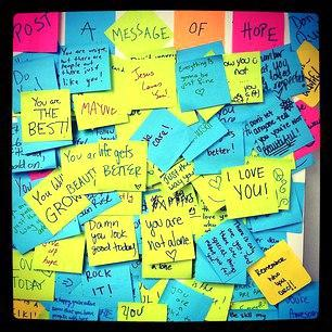 messages of support on colorful sticky notes