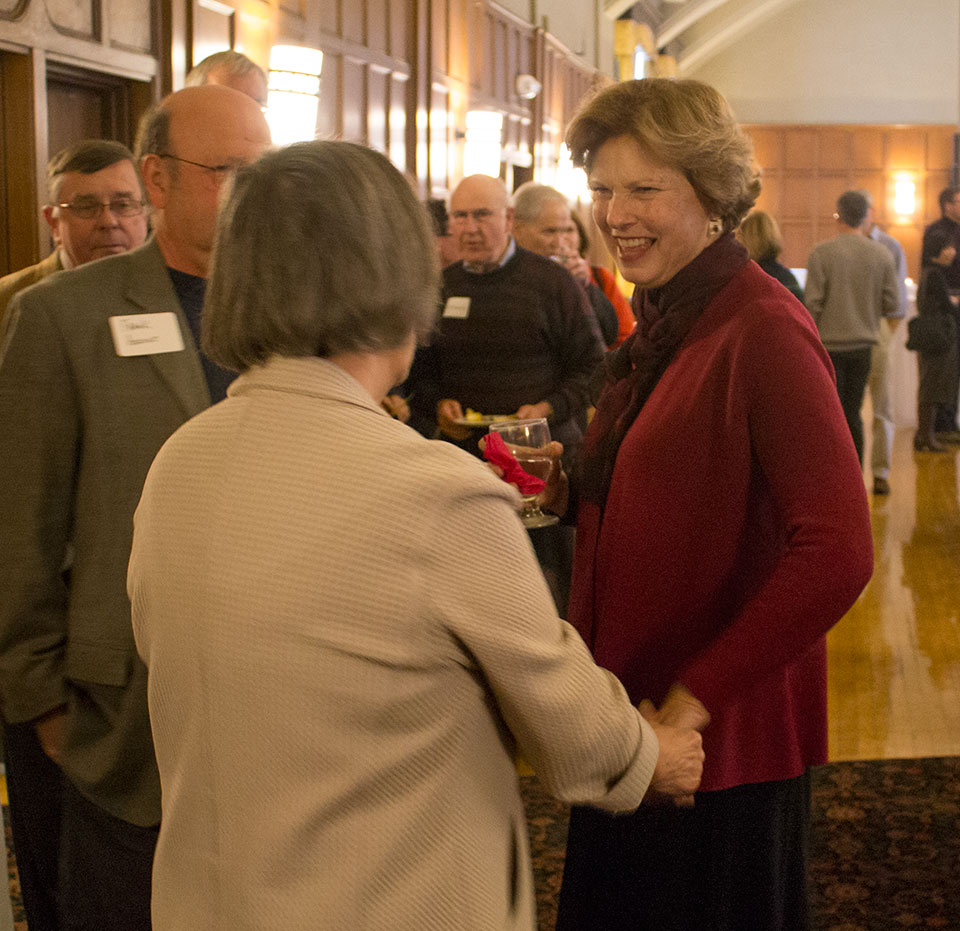 Dr. Cook talking with guests
