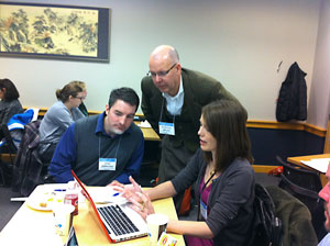 3 workshop participants discussing an activity