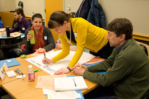 3 workshop participants working on an activity