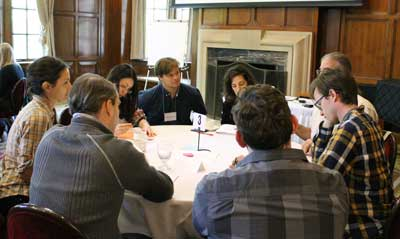Preparing Future Faculty Seminar participants sitting around a table and discussing an activity