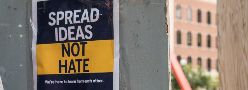 Flier that reads Spread Ideas, Not Hate. We are hear to learn from each other.