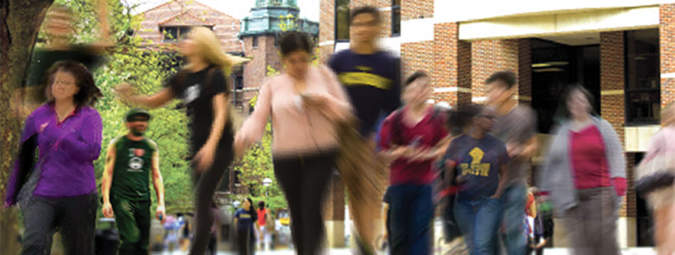 Blurred image of student walking on campus