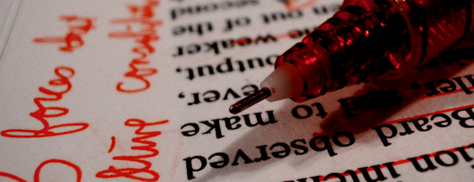 red pen with graded paper