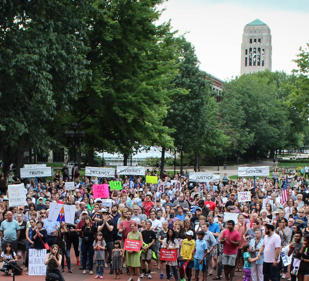 Crowd on Diag holding protest signs